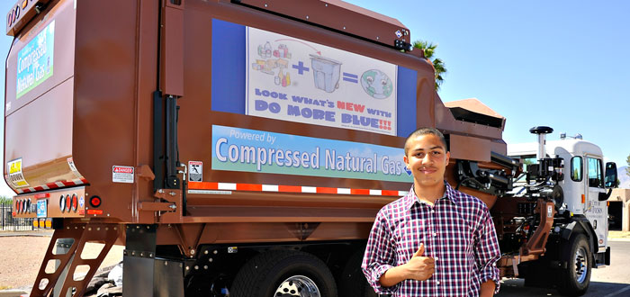 Photo of Ethan Bell and the recycling truck