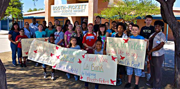 Booth Fickett students holding thank you signs for Citi