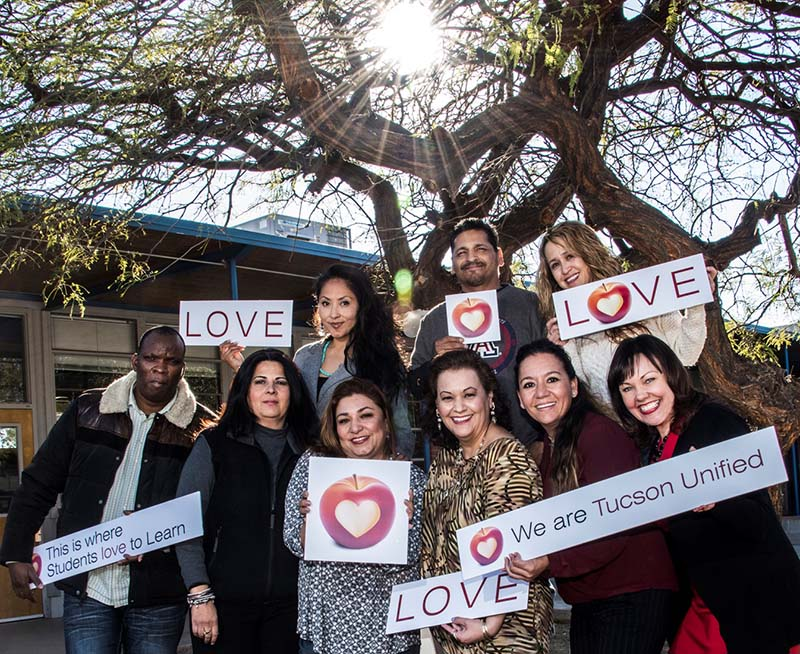 photo of Team Family and Community Outreach, Top row (from left): Aggie Hart, Salmineo J. Silvas, Belen Gamez; bottom row (from left): Alain Ndoumba, Rosa Maria Escalante, Elga Torres, Anna Caro Read, Alma Iñiguez, Terri Howard. Absent: Lydia Chavaria