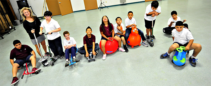 Photo of students with exercise equipment