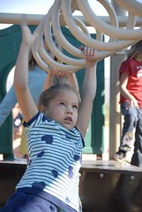 Image of child playing on rings.