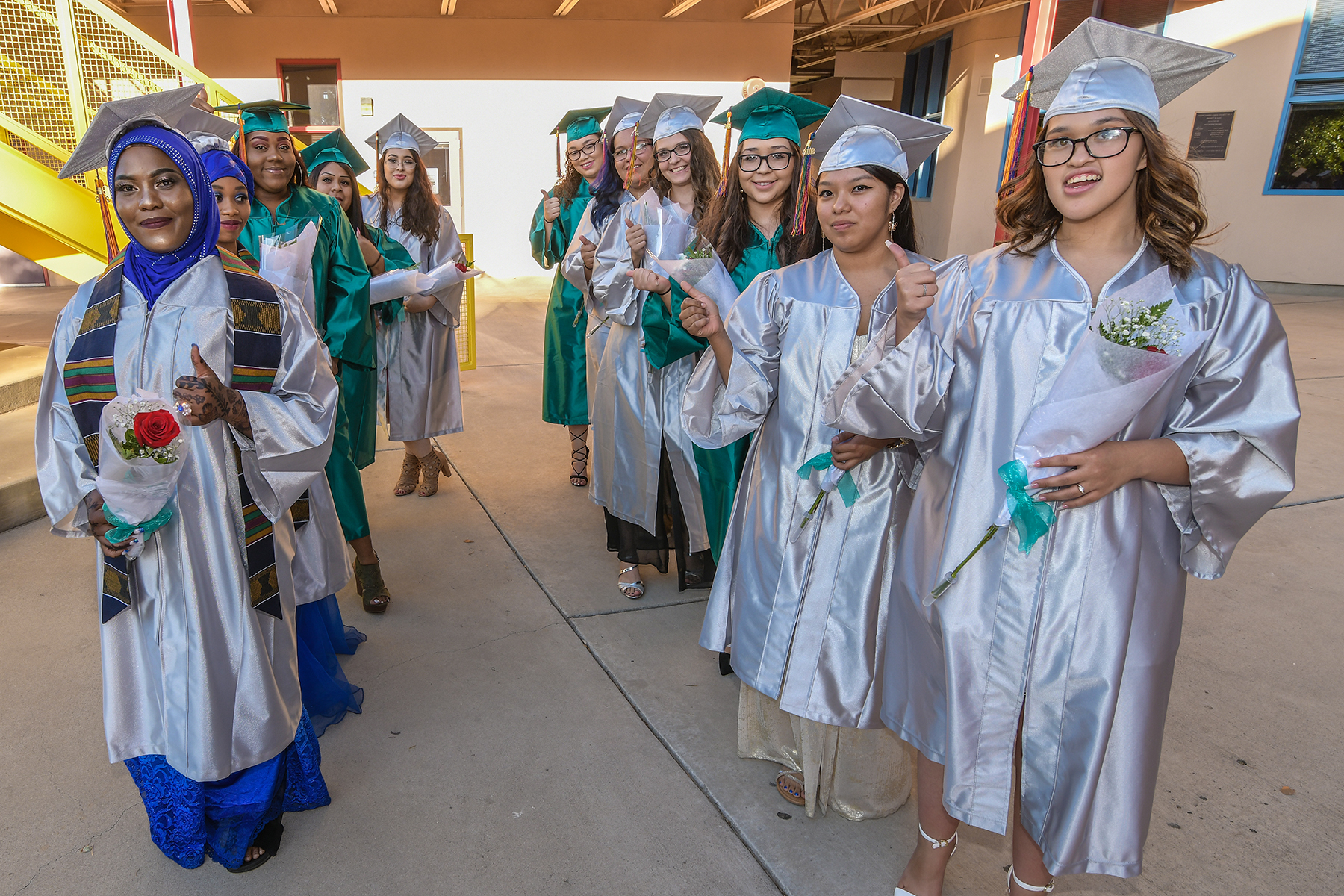 TAP HS 2018 Spring Grads walking in